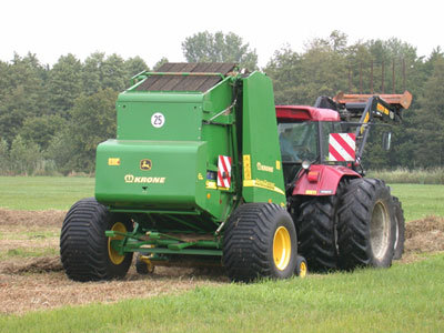 Round baler for use in very wet areas
