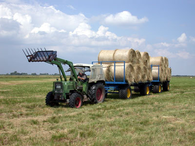 Trailer with wide tyres used to remove bales of hay from wet areas